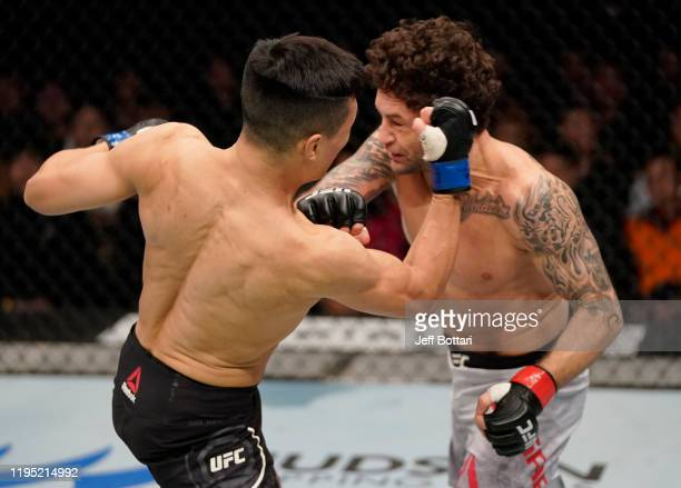 Chan Sung Jung of South Korea punches Frankie Edgar in their featherweight fight during the UFC Fight Night event at Sajik Arena 3 on December 21...