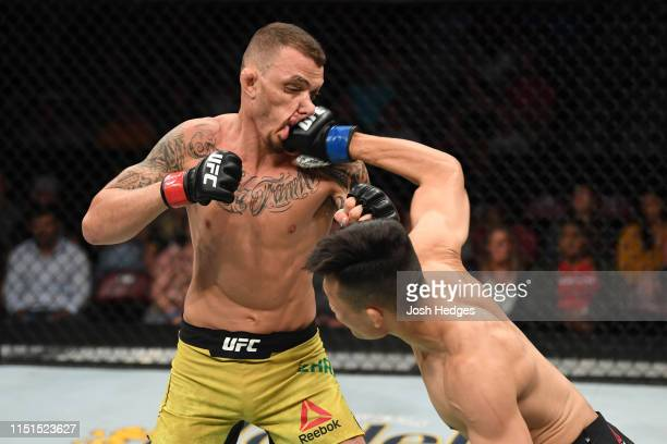 Chan Sung Jung of South Korea punches Renato Moicano of Brazil in their featherweight bout during the UFC Fight Night event at Bon Secours Wellness...