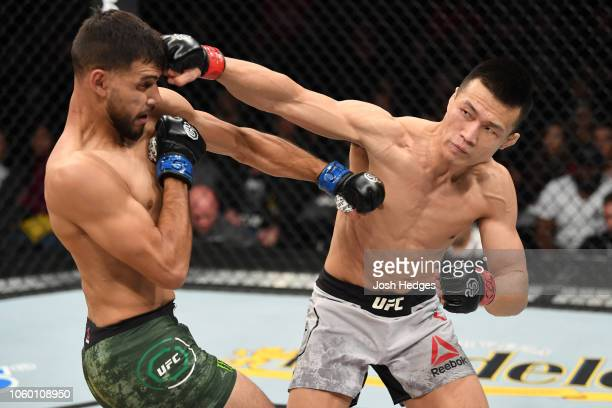 Chan Sung Jung of South Korea punches Yair Rodriguez of Mexico in their featherweight bout during the UFC Fight Night event inside Pepsi Center on...
