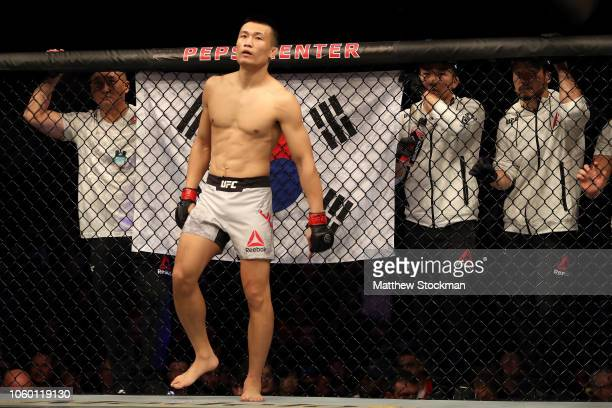 Chan Sung Jung of South Korea wiats for his introduction to begin against Yair Rodriguez of Mexico in their Featherweight bout during the UFC Fight...