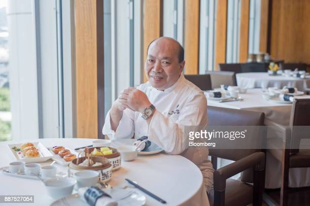 Chan Yan Tak executive chef at Lung King Heen restaurant sits for a photograph at the restaurant inside the Four Seasons Hotel in Hong Kong China on...