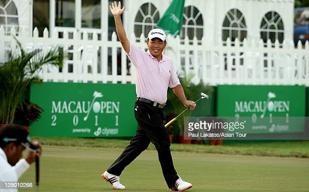Chan YihShin of Chinese Taipei celebrates an eagle on the 18th green during round one of the Macau Open at Macau Golf Country Club on September 15...