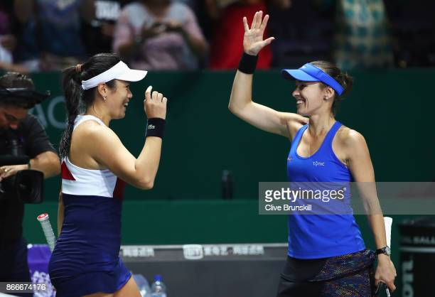 Chan YungJan of Chinese Taipei and Martina Hingis of Switzerland celebrate victory in their doubles match against Kveta Peschke of Czech Republic and...
