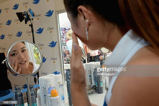 Chan Yungjan of Chinese Taipei has her nails and hair done at Grand Slam Oval Dove activation during day two of the 2013 Australian Open at Melbourne...