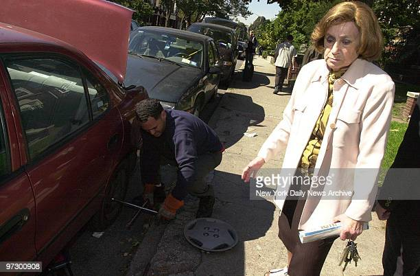 Chana Popack waits while her slashed tire is changed on Montgomery St in Crown Heights Brooklyn More than 40 cars were vandalized while Jews were...
