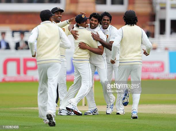 Chanaka Welegedara of Sri Lanka celebrates the wicket of Andrew Strauss of England with team mates during day four of the 2nd npower Test Match...