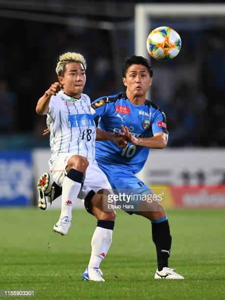 Chanathip Songkrasin of Consadole Sapporo and Ryota Oshima of Kawasaki Frontale compete for the ball during the JLeague J1 match between Kawasaki...