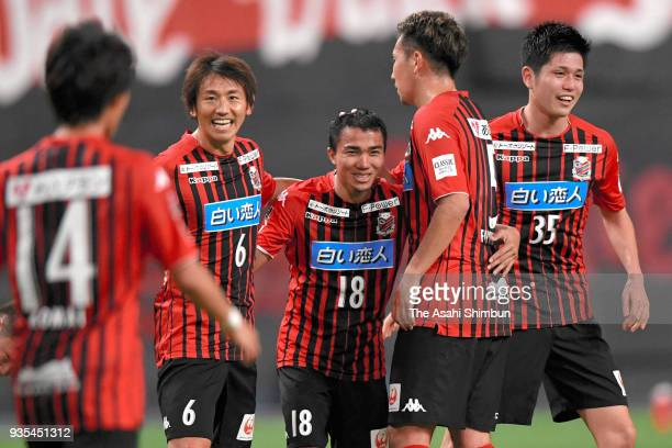 Chanathip Songkrasin of Consadole Sapporo celebrates scoring his side's second goal with his team mates during the JLeague J1 match between Consadole...