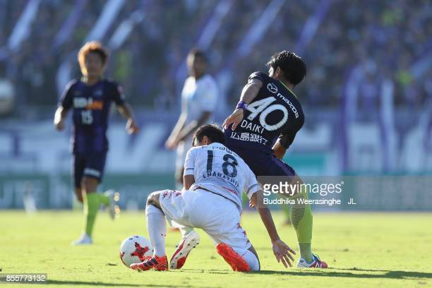 Chanathip Songkrasin of Consadole Sappporo and Daiki Niwa of Sanfrecce Hiroshima compete for the ball during the JLeague J1 match between Sanfrecce...