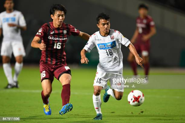 Chanathip Songkrasin of Consadole Sappporo and Hideto Takahashi of Vissel Kobe compete for the ball during the JLeague J1 match between Vissel Kobe...