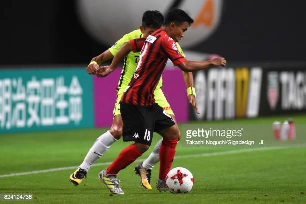 Chanathip Songkrasin of Consadole Sappporo controls the ball under pressure of Ryota Moriwaki of Urawa Red Diamonds during the JLeague J1 match...