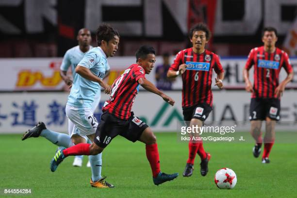 Chanathip Songkrasin of Consadole Sappporo controls the ball under pressure of Daiki Ogawa of Jubilo Iwata during the JLeague J1 match between...