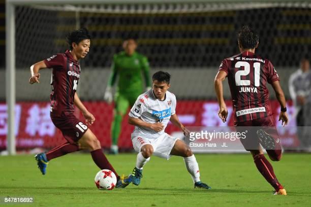 Chanathip Songkrasin of Consadole Sappporo controls the ball under pressure of Hideto Takahashi and Junya Tanaka of Vissel Kobe during the JLeague J1...