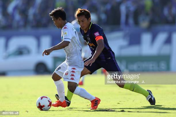 Chanathip Songkrasin of Consadole Sappporo controls the ball under pressure of Toshihiro Aoyama of Sanfrecce Hiroshima during the JLeague J1 match...