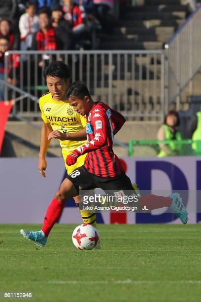 Chanathip Songkrasin of Consadole Sappporo controls the ball under pressure of Yuta Nakayama of Kashiwa Reysol during the JLeague J1 match between...