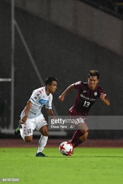 Chanathip Songkrasin of Consadole Sappporo takes on Keijiro Ogawa of Vissel Kobe during the JLeague J1 match between Vissel Kobe and Consadole...