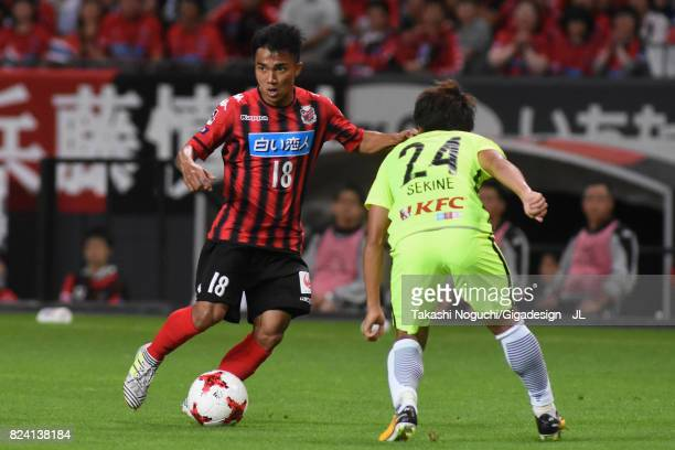 Chanathip Songkrasin of Consadole Sappporo takes on Takahiro Sekine of Urawa Red Diamonds during the JLeague J1 match between Consadole Sapporo and...
