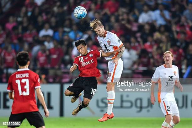 Chanathip Songkrasin of Muangthong United and Jacob Pepper Brisbane Roar competes for the ball during the AFC Asian Champions League Group Stage...
