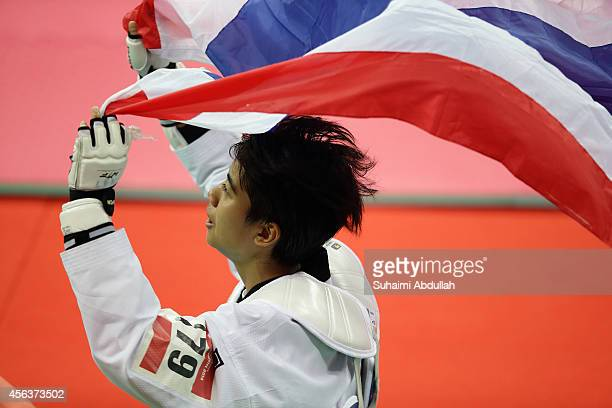 Chanatip Sonkham of Thailand celebrates after defeating Li Zhao Yi of China to win the gold medal in the women taekwondo 49kg final on day eleven of...