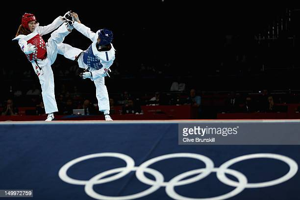 Chanatip Sonkham of Thailand competes against Kristina Kim of Russia during the womens 49kg Preliminary Taekwondo on Day 12 of the London 2012...
