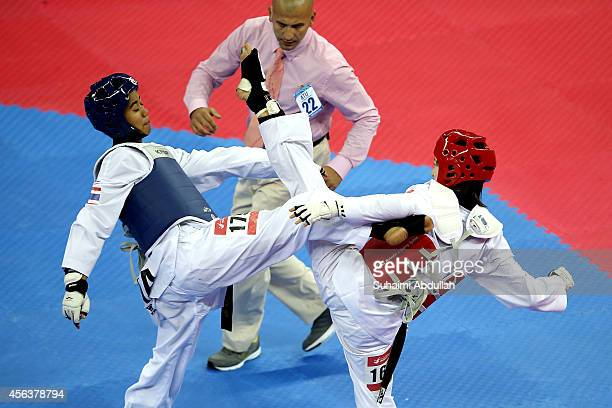 Chanatip Sonkham of Thailand competes with Li Zhaoyi of China during the women 49kg gold medal final on day eleven of the 2014 Asian Games at Ganghwa...