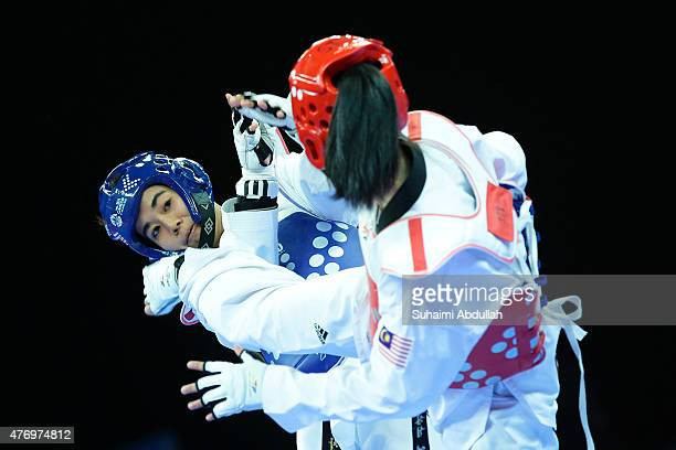 Chanatip Sonkham of Thailand fights Nur Dhia Liyana Shaharuddin of Malaysia in the women's taekwondo under 49kg quarterfinals match at the Expo Hall...