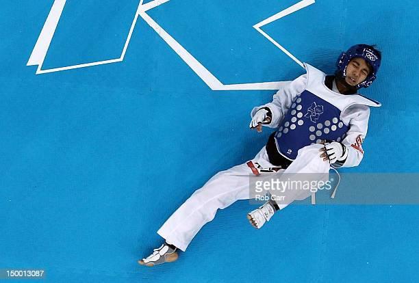 Chanatip Sonkham of Thailand lies on the floor during the Women's 49kg Taekwondo bronze medal match against Elizabeth Zamora Gordillo of Guatemala on...