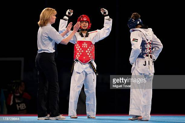 Chanatip Sonkham of Thailand reacts after being defeated by Dana Touran of Jordan the women«s 49 kg final combat of WTF World Taekwondo Championships...