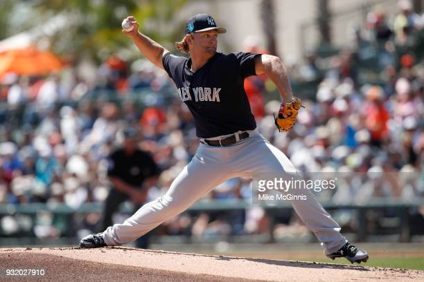 Chance Adams of the New York Yankees pitches during the first inning of the Spring Training game against the Baltimore Orioles at Spectrum Field on...