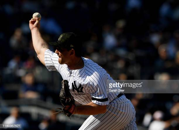 Chance Adams of the New York Yankees pitches during the ninth inning of the game against the Tampa Bay Rays at Yankee Stadium on May 19, 2019 in the...