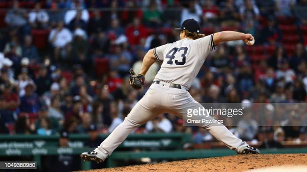 Chance Adams of the New York Yankees pitches in the bottom of the eighth inning of the game against the Boston Red Sox at Fenway Park on September...