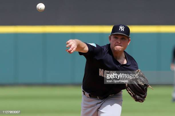 Chance Adams of the Yankees delivers a pitch to the plate during the spring training game between the New York Yankees and the Detroit Tigers on...