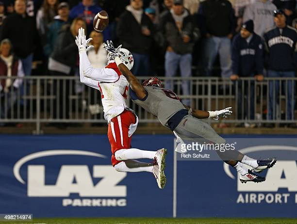 Chance Allen of the Houston Cougars catches a long pass for a touchdown as Jhavon Williams of the Connecticut Huskies defends during the fourth...