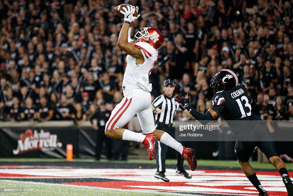 Chance Allen #21 of the Houston Cougars leaps for a 39-yard touchdown reception against Grant Coleman #13 of the Cincinnati Bearcats in the first half at Nippert Stadium on September 15, 2016 in Cincinnati, Ohio.