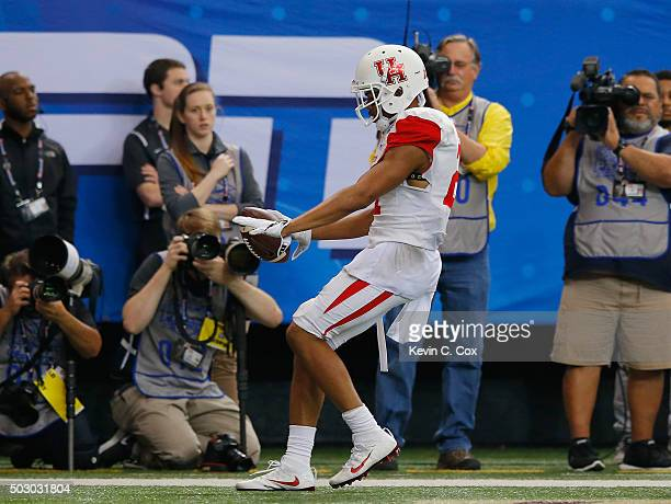 Chance Allen of the Houston Cougars scores a touchdown in the fourth quarter against the Florida State Seminoles during the ChickfilA Peach Bowl at...