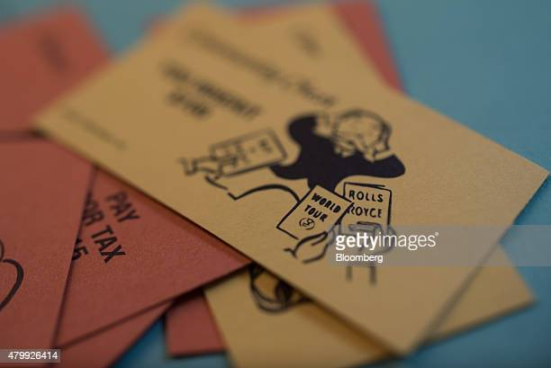 Chance and Community Chest cards are arranged on a Hasbro Inc Monopoly board game for a photograph taken with a tiltshift lens in Oradell New Jersey...