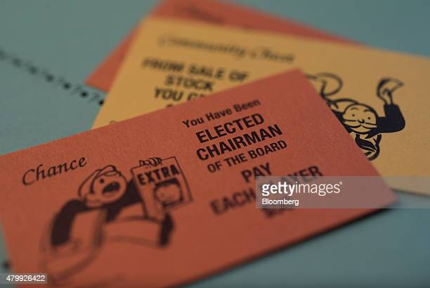 Chance and Community Chest cards are arranged on a Hasbro Inc. Monopoly board game for a photograph taken with a tilt-shift lens in Oradell, New...