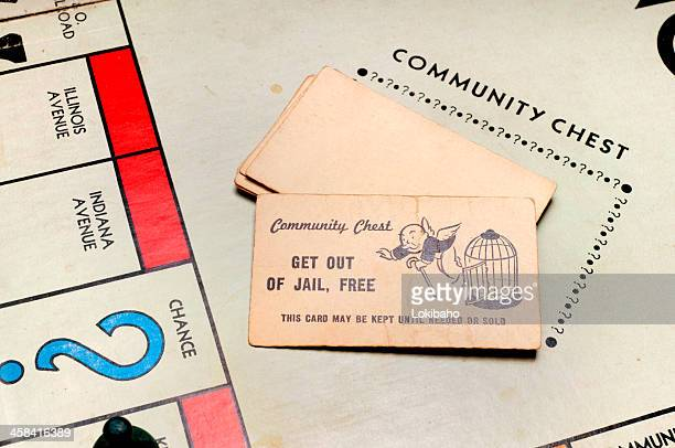 chance and community chest from classic monopoly game - game night stock photos and pictures