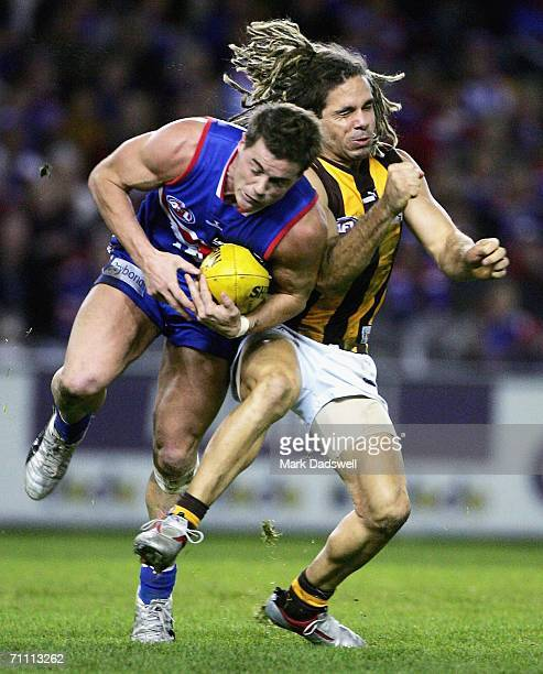 Chance Bateman of the Hawks attempts to knock Matthew Robbins of the Bulldogs off the ball during the round 10 AFL match between the Western Bulldogs...