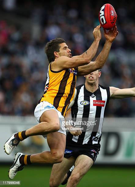 Chance Bateman of the Hawks attempts to mark during the round 15 AFL match between the Collingwood Magpies and the Hawthorn Hawks at Melbourne...