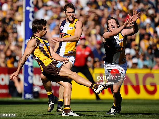 Chance Bateman of the Hawks kick is smothered by Patrick McGinnity of the Eagles during the round seven AFL match between the West Coast Eagles and...