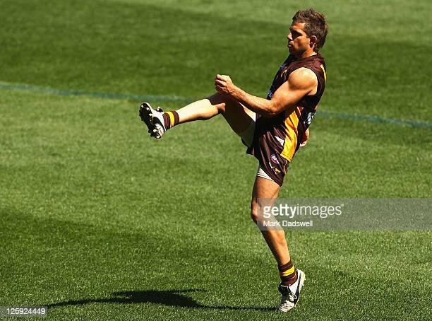 Chance Bateman of the Hawks kicks for goal during a Hawthorn Hawks AFL training session at Melbourne Cricket Ground on September 22 2011 in Melbourne...