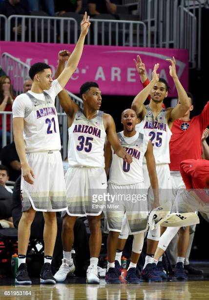 Chance Comanche Allonzo Trier Parker JacksonCartwright and Keanu Pinder of the Arizona Wildcats celebrate on the bench late in their semifinal game...