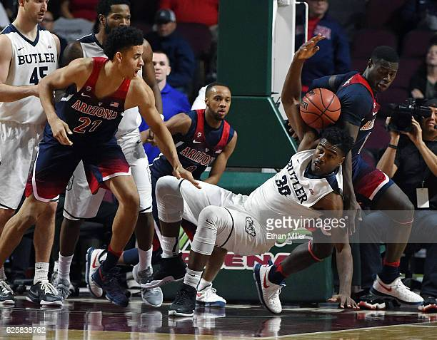 Chance Comanche of the Arizona Wildcats Kelan Martin of the Butler Bulldogs and Rawle Alkins of the Wildcats go after a loose ball during the...