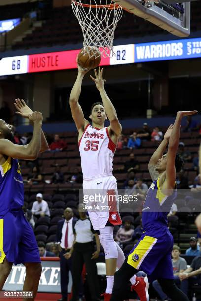 Chance Comanche of the Memphis Hustle shoots the ball against the Santa Cruz Warriors during an NBA GLeague game on March 10 2018 at Landers Center...