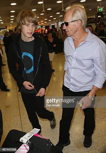 Chance Hogan and Paul Hogan arrive at Sydney International Airport on December 18 2013 in Sydney Australia