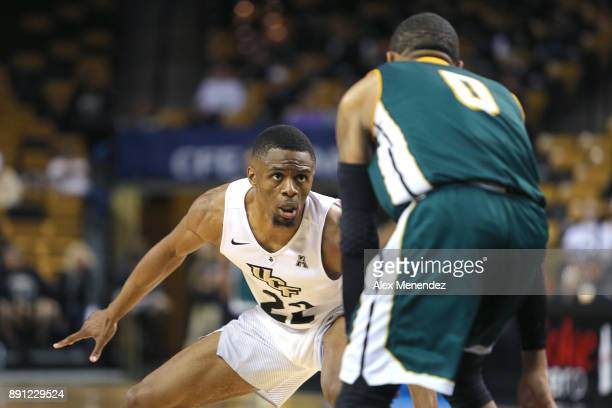 Chance McSpadden of the UCF Knights defends against Marlain Veal of the Southeastern Louisiana Lions during a NCAA basketball game at the CFE Arena...