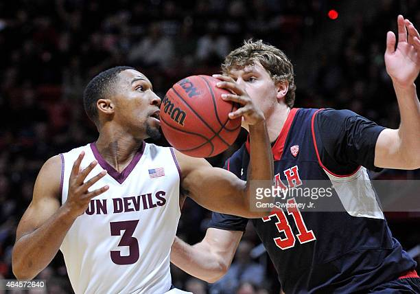 Chance Murray of the Arizona State Sun Devils looks toward the basket and past defender Dallin Bachynski of the Utah Utes during first half action at...