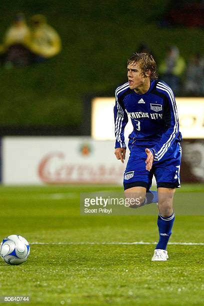 Chance Myers of the Kansas City Wizards dribbles against the New England Revolution during the game at Community America Ballpark on April 9 2008 in...