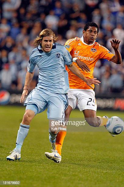Chance Myers of the Sporting Kansas City pushes off Carlo Costly Houston Dynamo in the second half during the MLS Eastern Conference Championship...